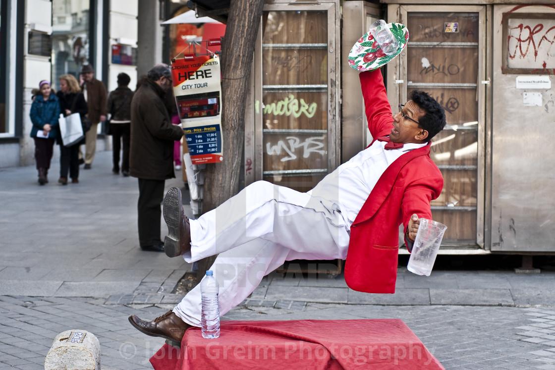 """""""Waiter falling street performer, Madrid, Spain"""" stock image"""