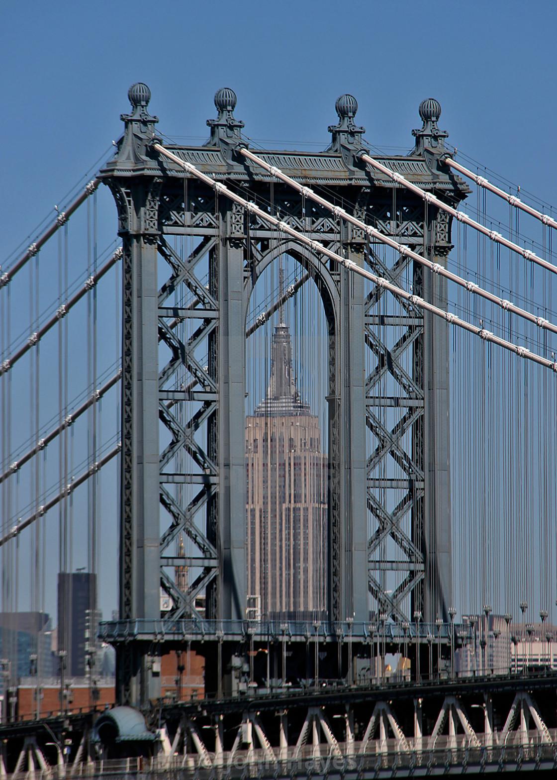 Empire State building through Brooklyn Bridge