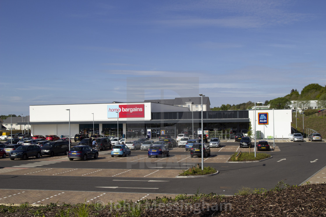 """""""Home Bargains and Aldi stores on the old Rolls-Royce site"""" stock image"""