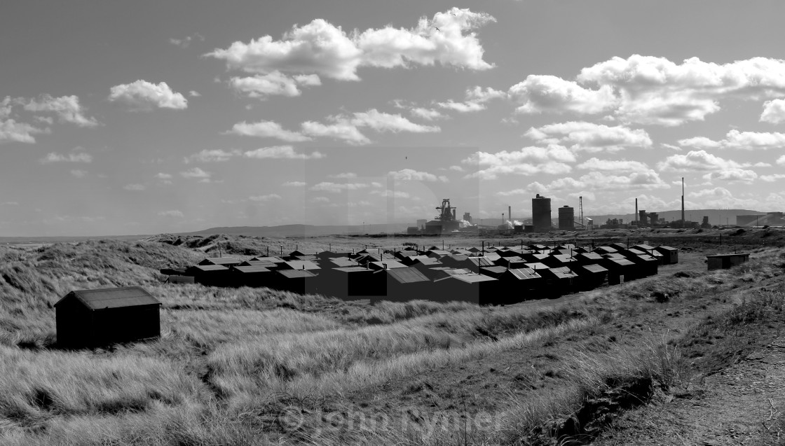 """""""Fisherman's huts and steel works at South Gare, Redcar."""" stock image"""