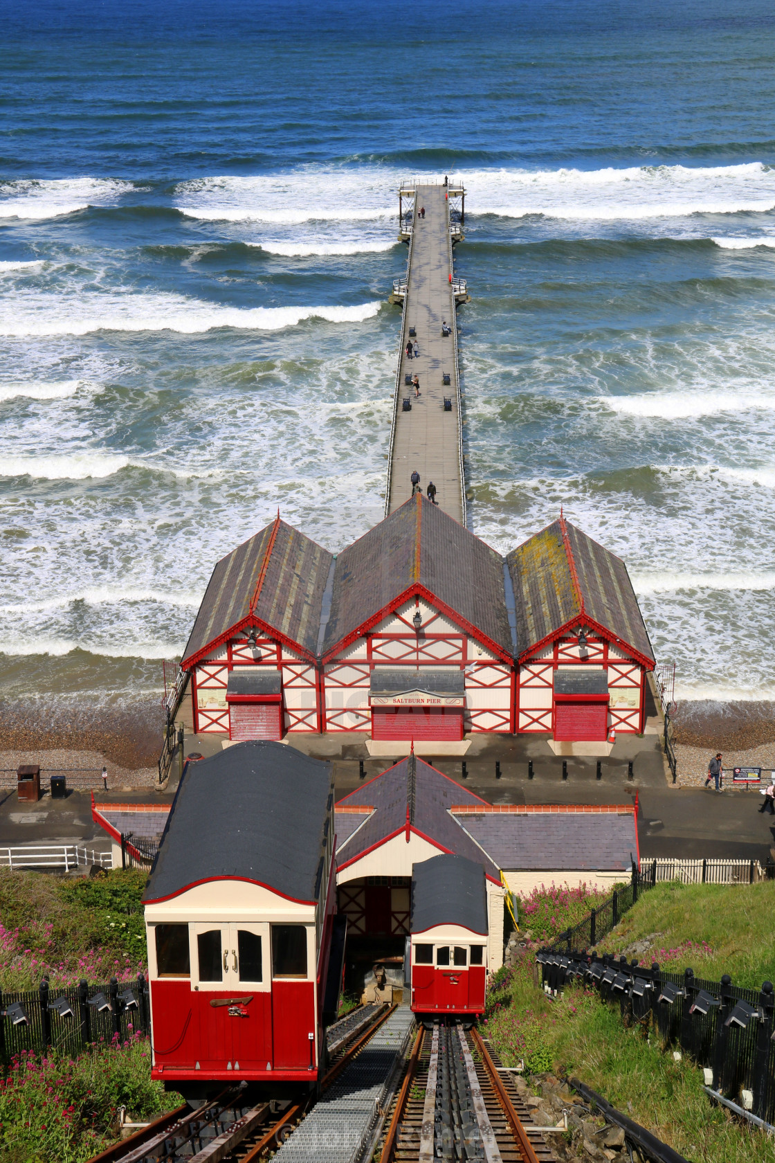 """""""Rough seas and Saltburn Pier. Cliff lift (funicular) parked up."""" stock image"""