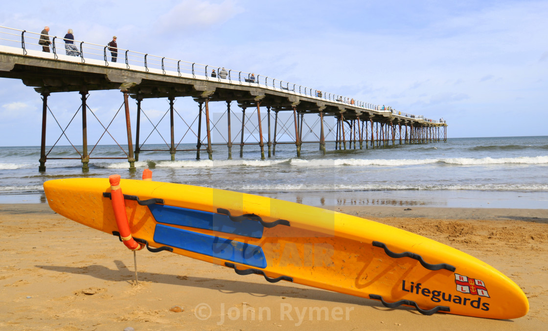 """""""Saltburn Pier and beach watched over by the Lifeguards."""" stock image"""