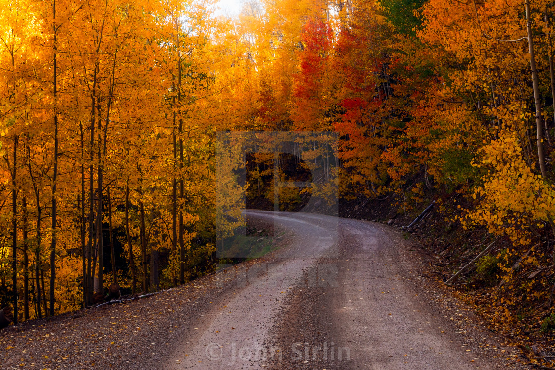 """Dirt road through a scenic autumn landscape"" stock image"