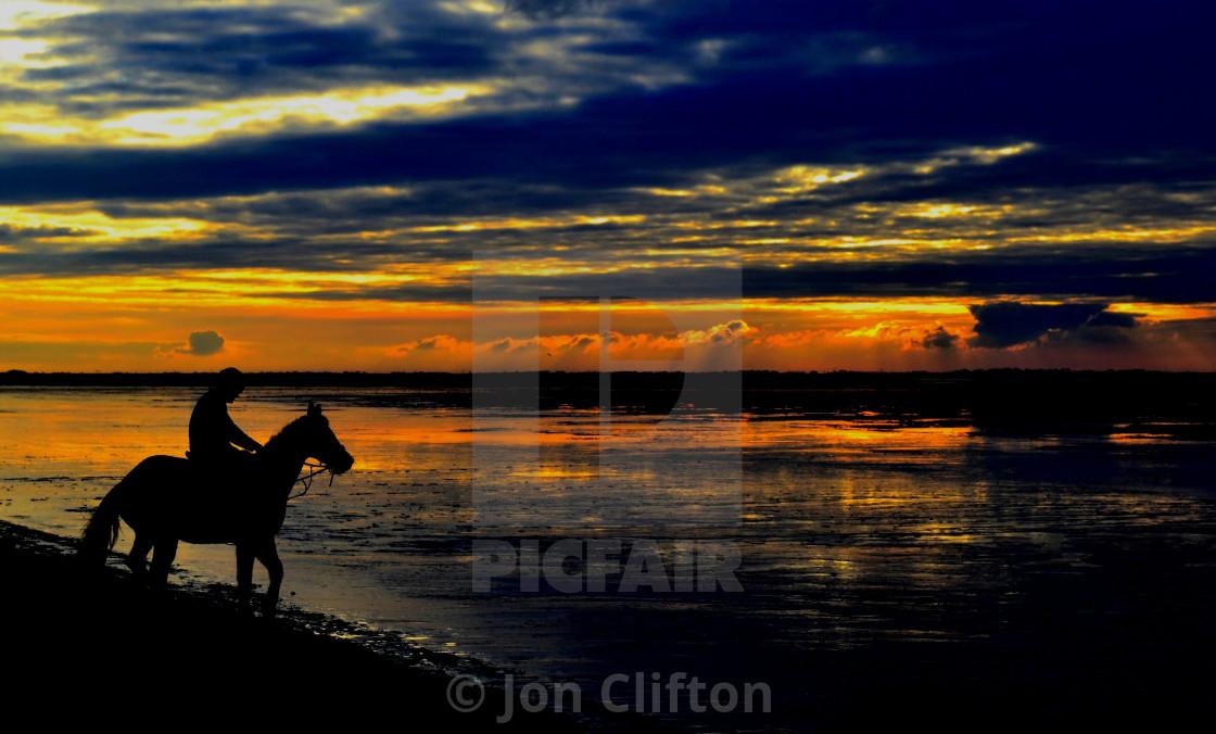 """The Sunset Rider"" stock image"
