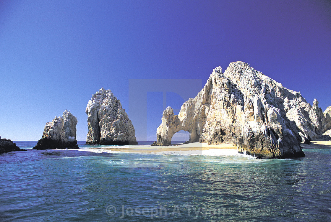 """The arch at Cabo San Lucas with sand"" stock image"