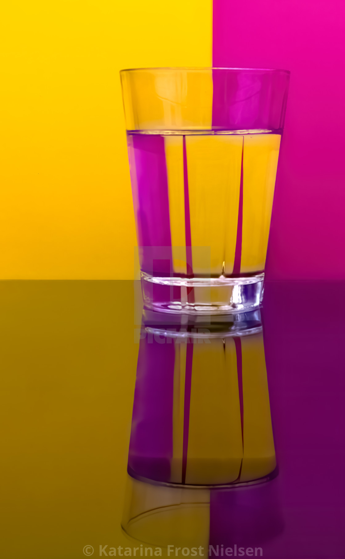 """""""Glass with water yellow and pink"""" stock image"""