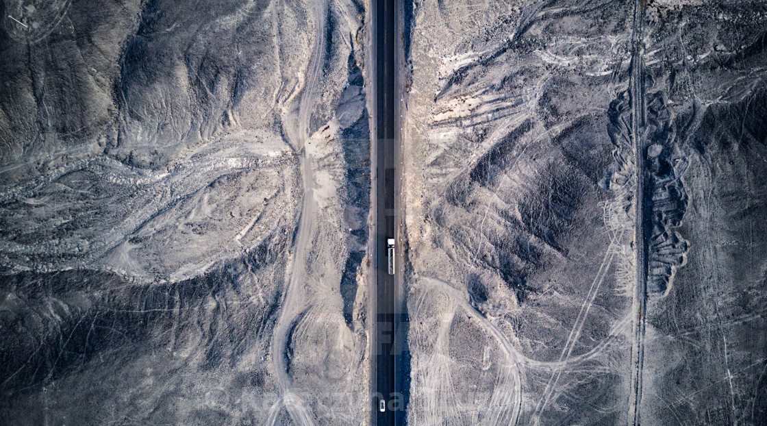 """""""Aerial top-down view on the Pan-American highway with A truck passing by the world's longest highway"""" stock image"""