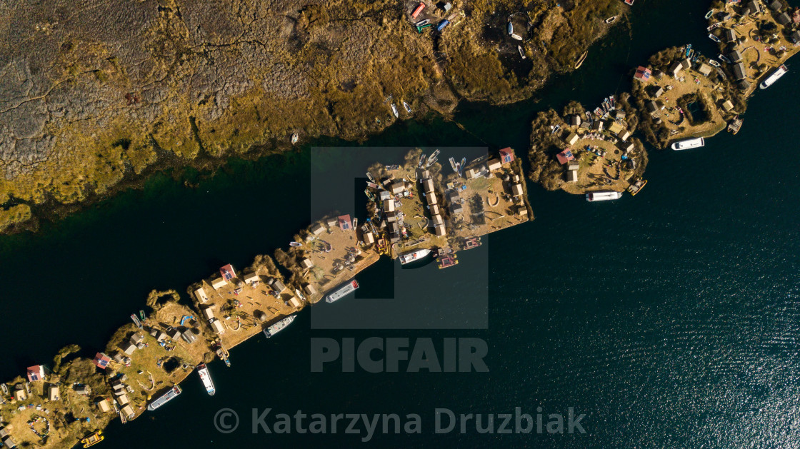 """""""Aerial top view photo of floating islands next to each other on Lake Titicaca"""" stock image"""
