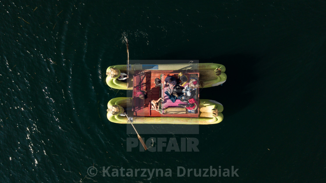 """""""Aerial top-down close up on traditional Uros boat"""" stock image"""