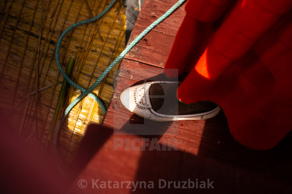 """""""The woman from Uros community on the traditional boat"""" stock image"""