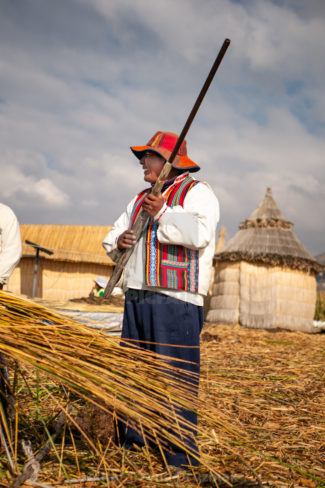"""The Uros man showing the tourists the weapon they use to hunt birds"" stock image"