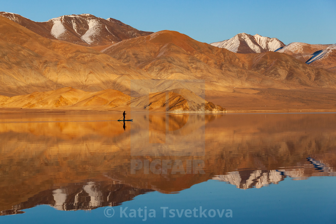 """""""SUP boarding Mirror reflection in calm lake."""" stock image"""