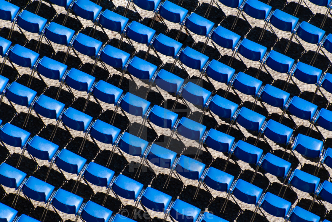 """""""Rows of Blue Seats casting a shadow"""" stock image"""