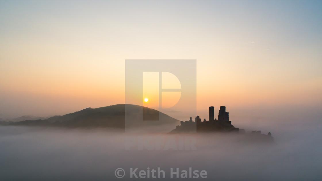 """Corfe Castle Sunrise on a Misty Morning"" stock image"