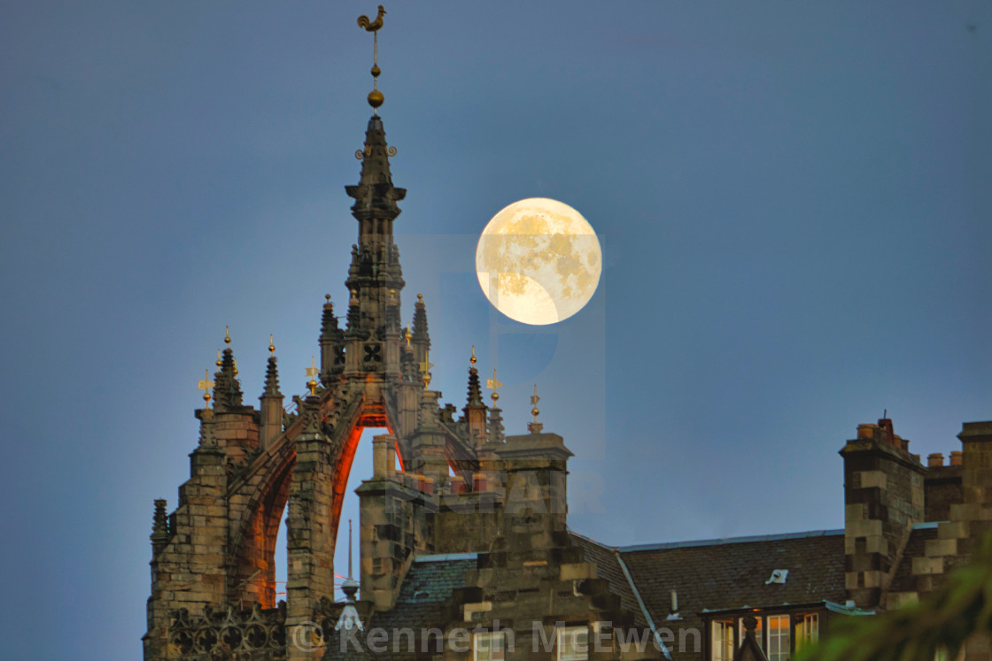"""Moon over St Giles in Edinburgh"" stock image"