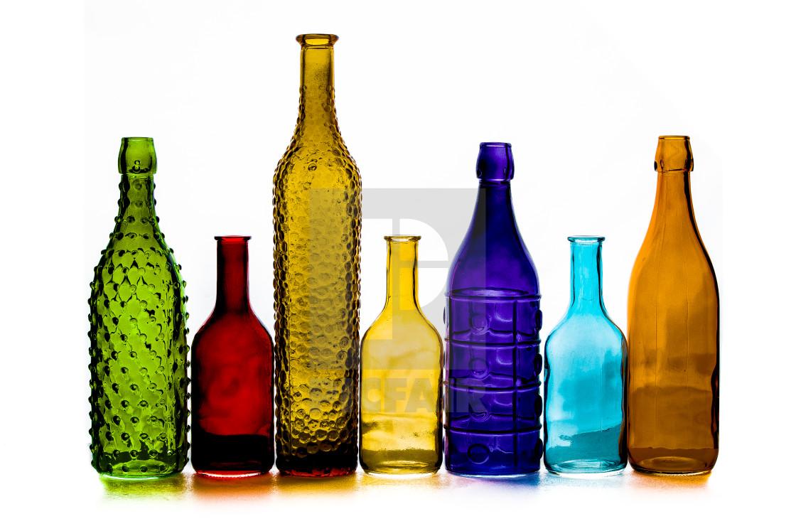 """""""Coloured glass bottles 4"""" stock image"""