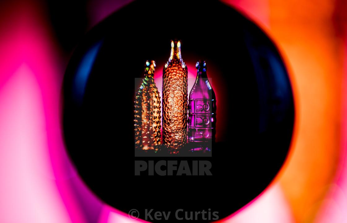 """""""Coloured glass bottles 5"""" stock image"""