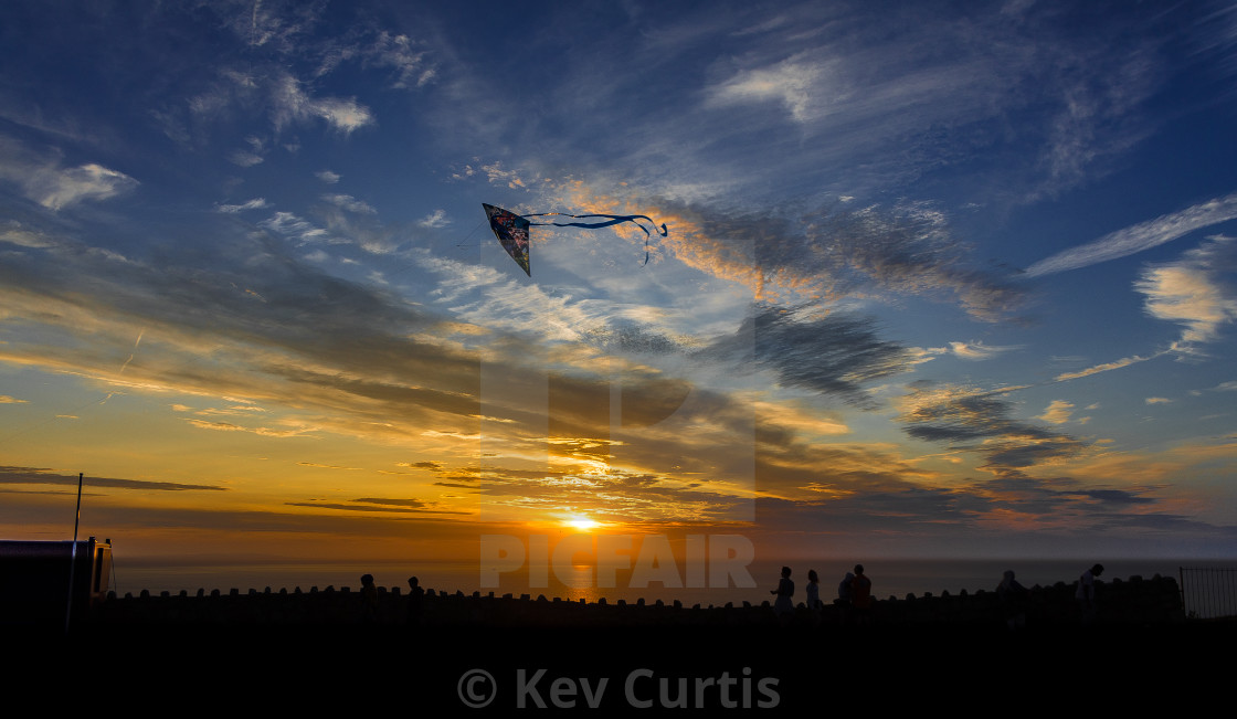 """Kite-flying at sunset"" stock image"