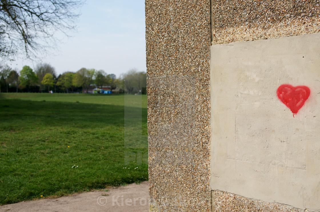 """Heart graffiti 'I love the outdoors' UK"" stock image"