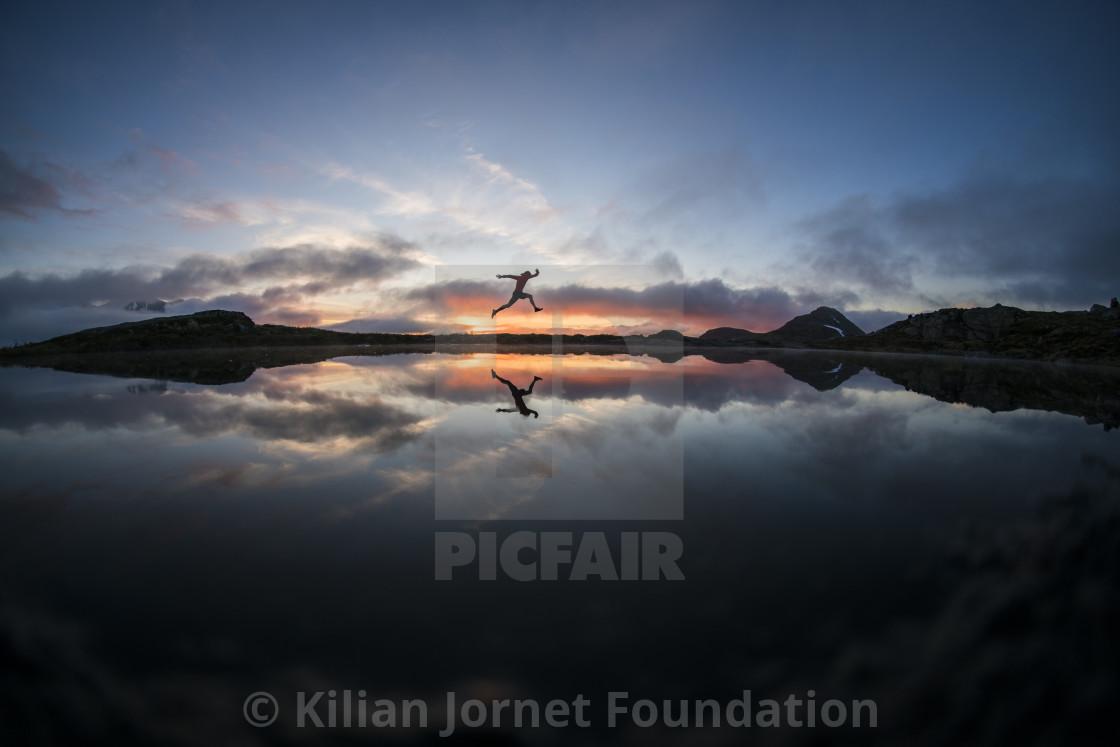 """Sunset lake jump"" stock image"