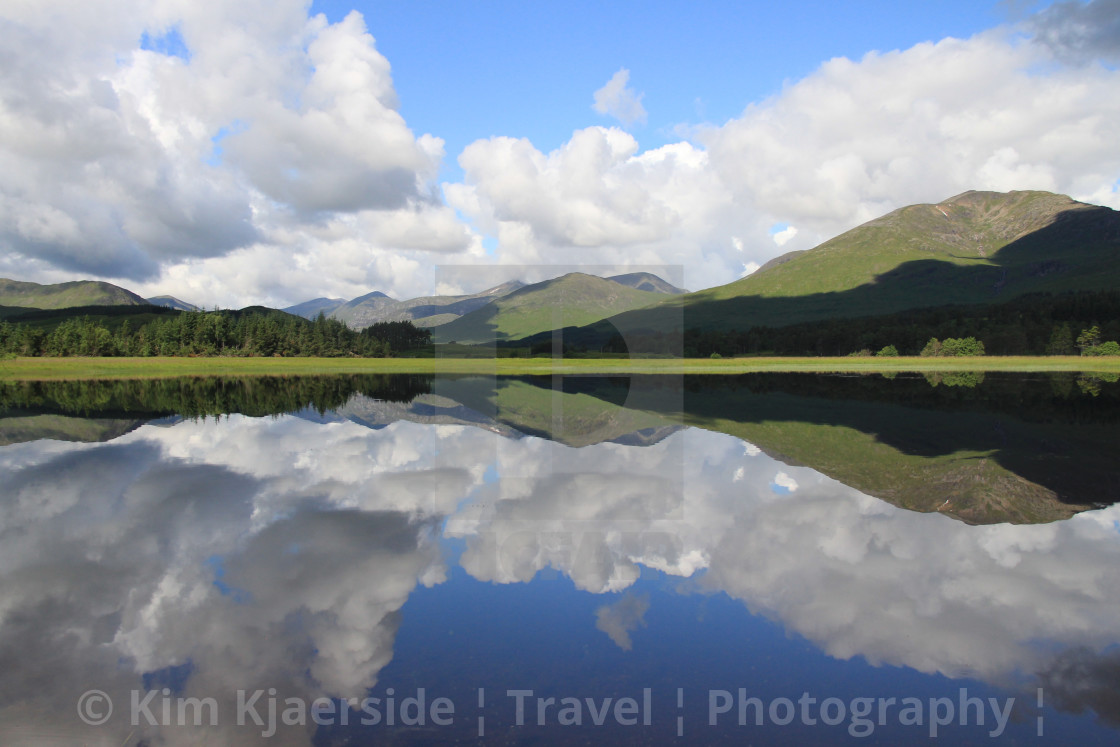 """""""Reflections on a Loch"""" stock image"""