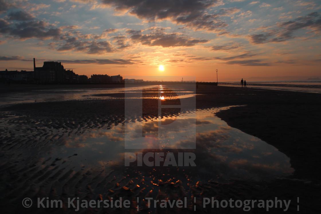 """Sunset walk at Portobello Beach"" stock image"