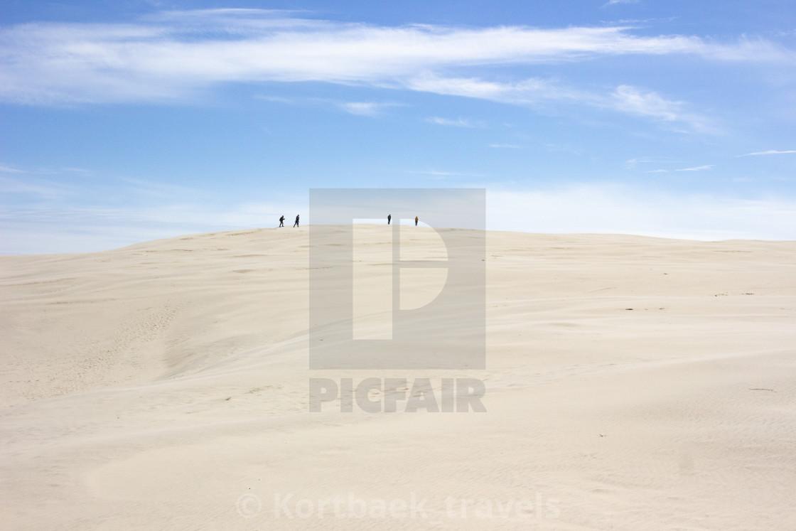 """Trekking on the Danish desert III"" stock image"