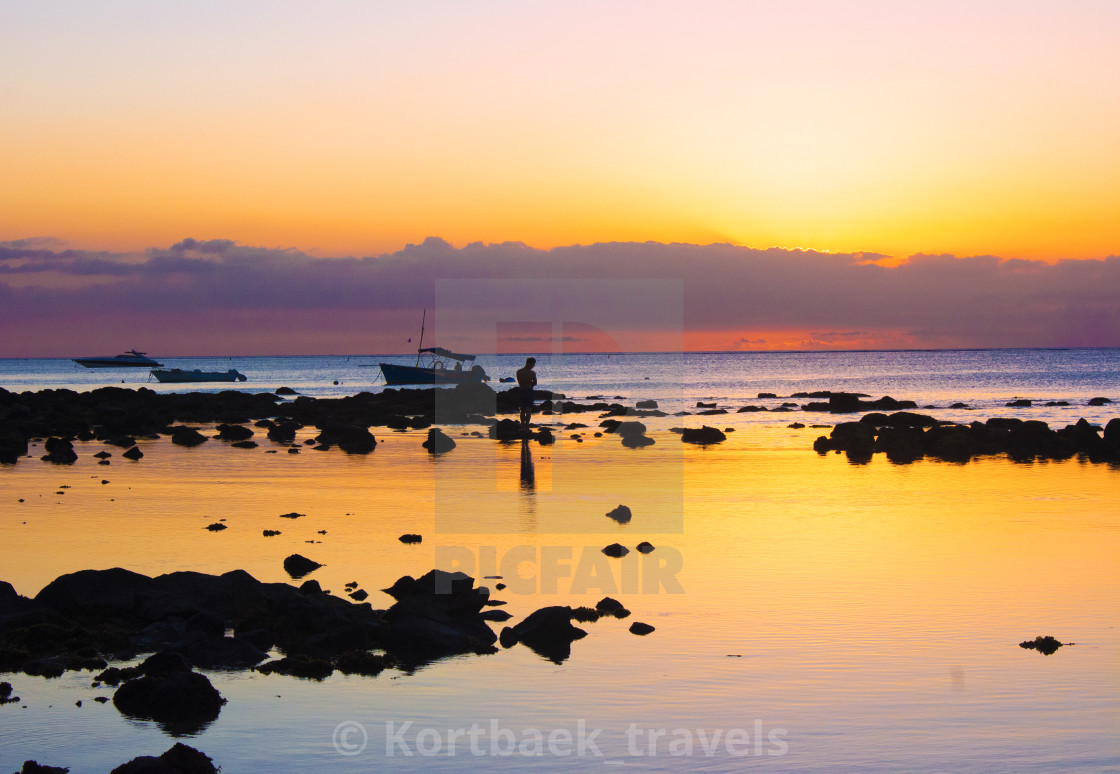 """Sunset on Mont Choisy Beach, Mauritius"" stock image"