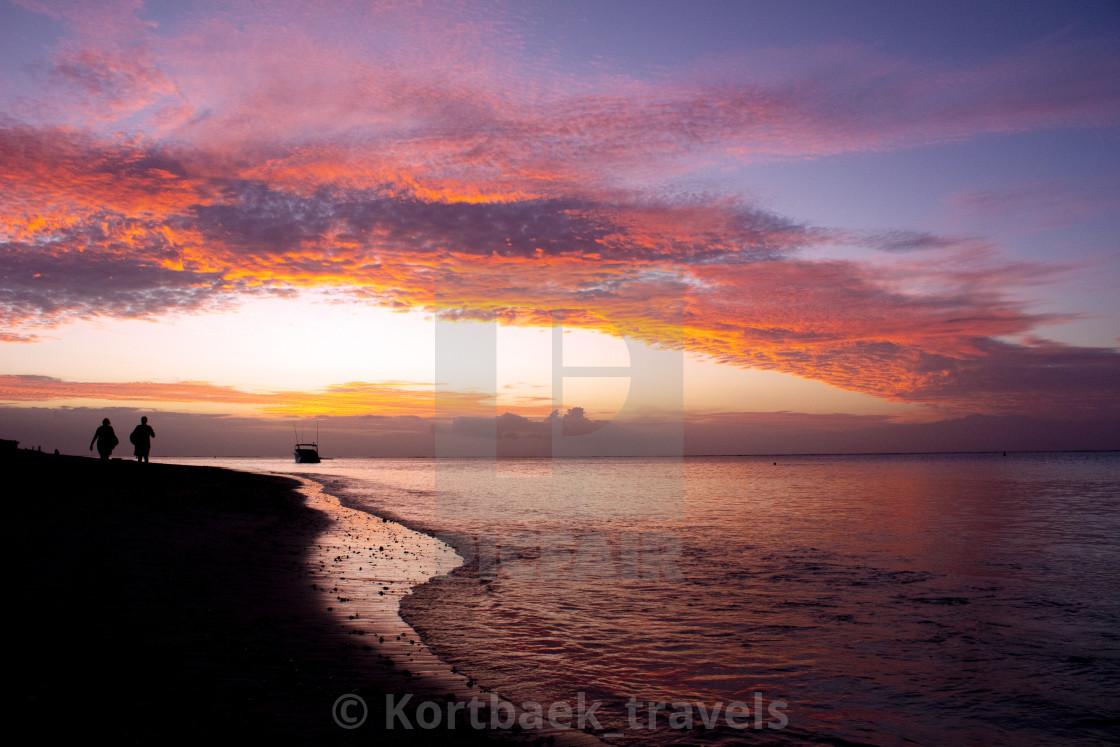 """Sunset on Mont Choisy Beach, Mauritius"" stock image"