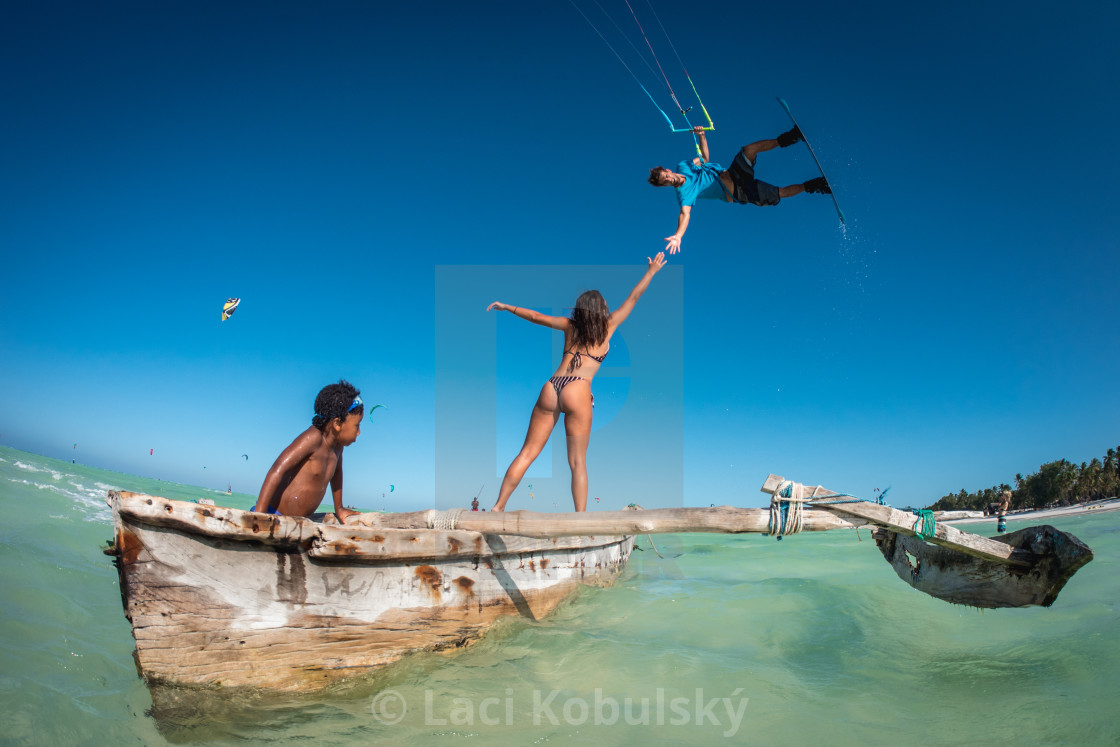 """Kiteboarding over a boat"" stock image"