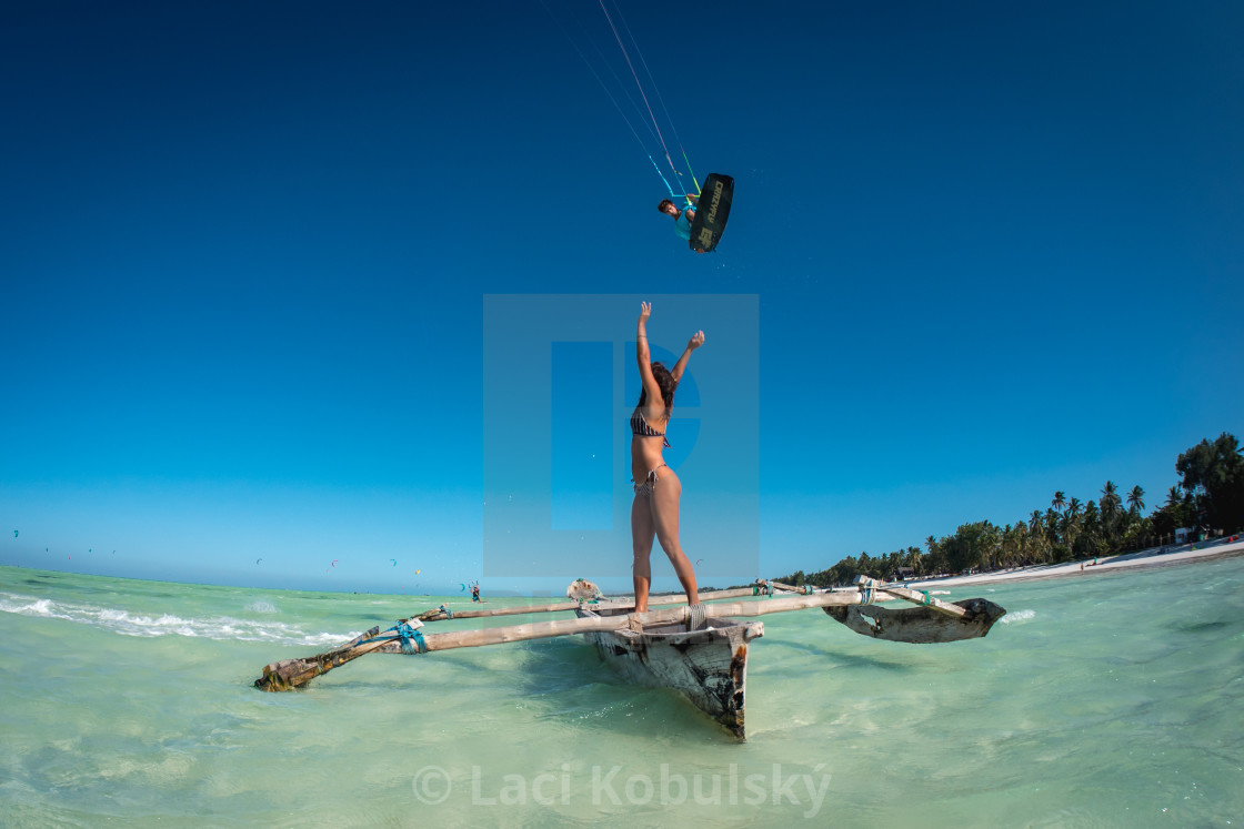 """""""Kiteboarding over a boat"""" stock image"""