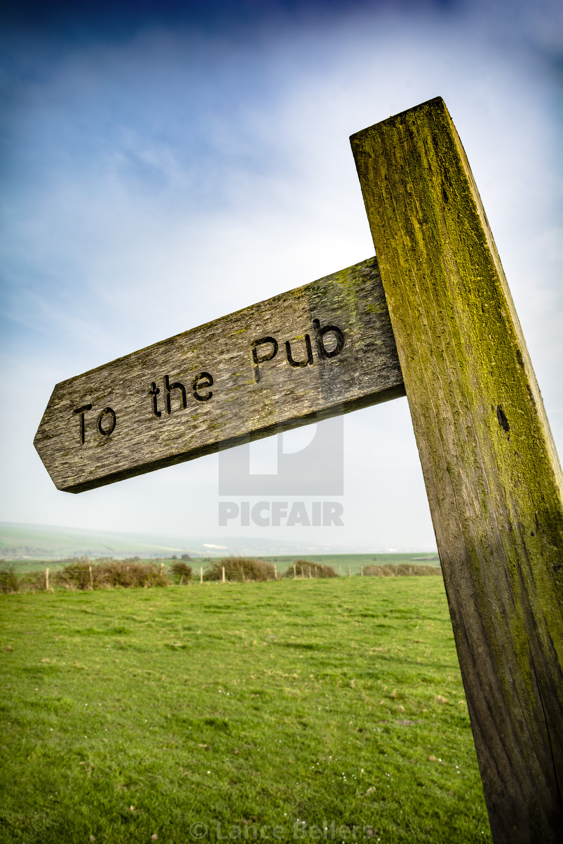 """To the pub sign in rural English setting"" stock image"