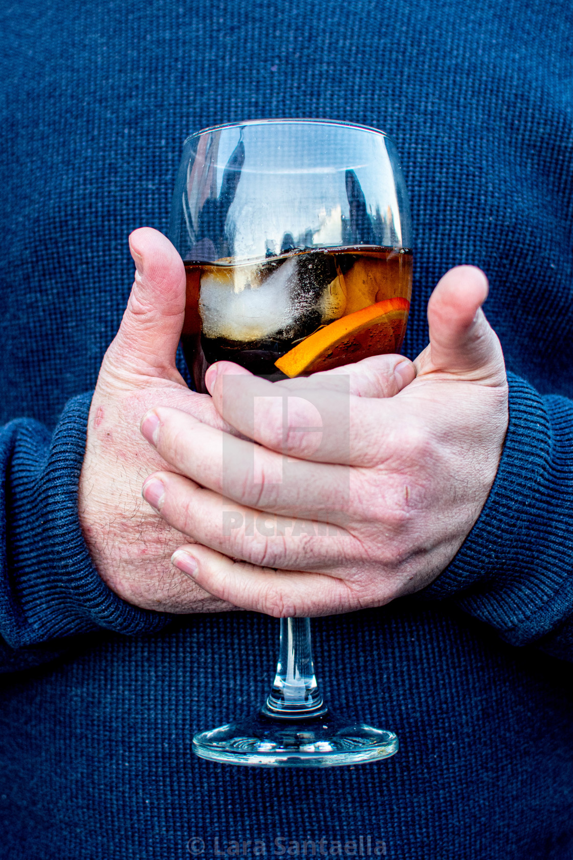 """""""Cradling a drink"""" stock image"""