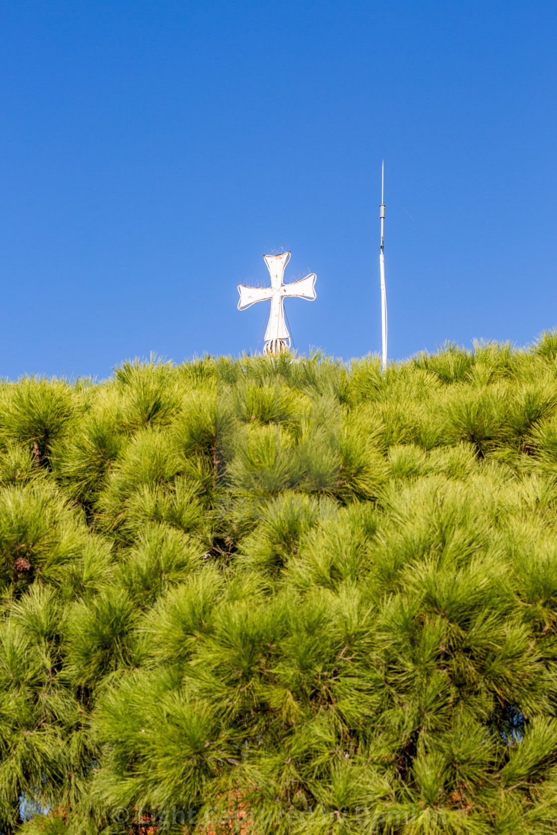 """Porto Lagos church cross view against blue sky"" stock image"