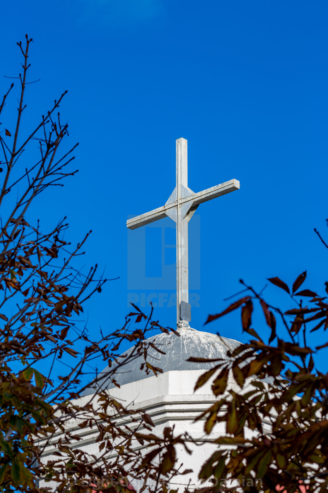 """Fanari church cross view against blue sky"" stock image"