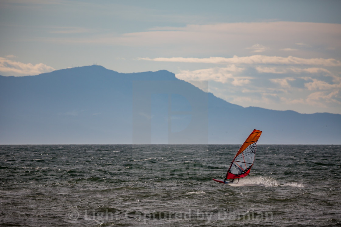 """Windsurfer silhouette in Thracian sea at winter"" stock image"
