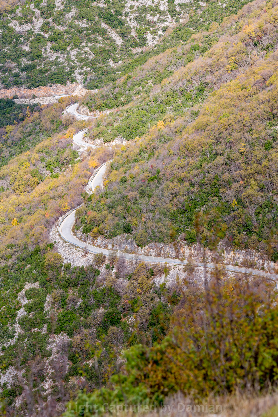 """Curvy mountain empty road in Greece"" stock image"