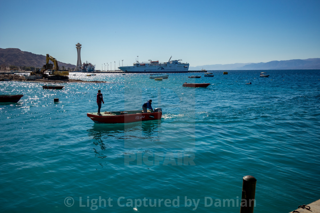 """Aqaba, Jordan, fishermen in small boat"" stock image"
