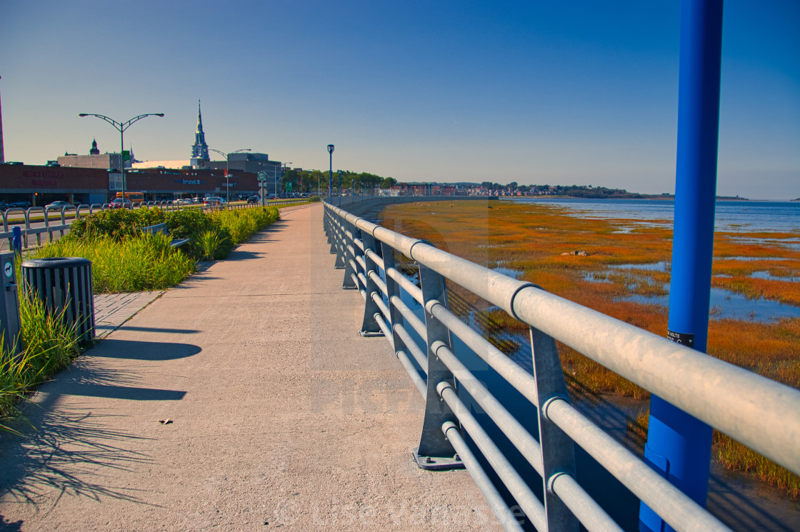 """""""The pedestrian sidewalk that runs along the St. Lawrence River."""" stock image"""