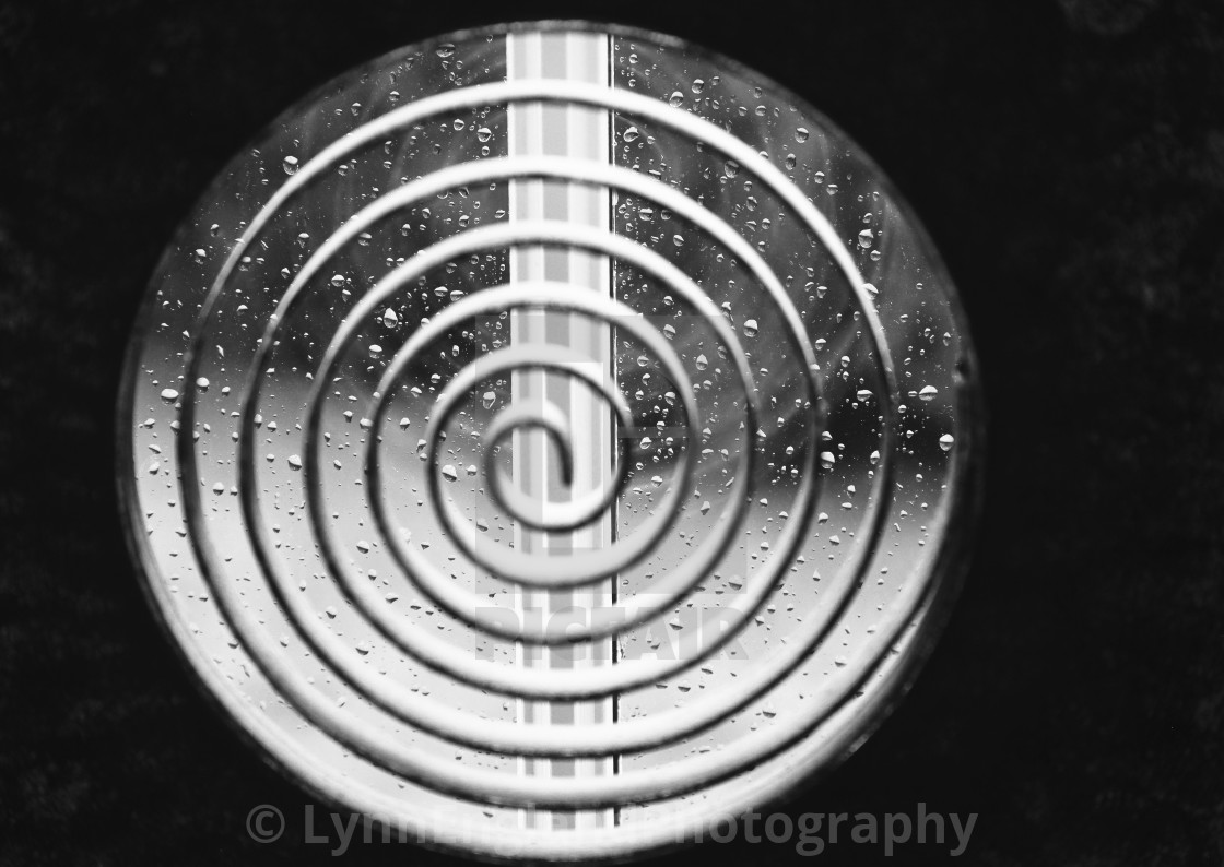 """Monochrome Lockdown spiral.....raindrops on a window via a spiral sculpture"" stock image"