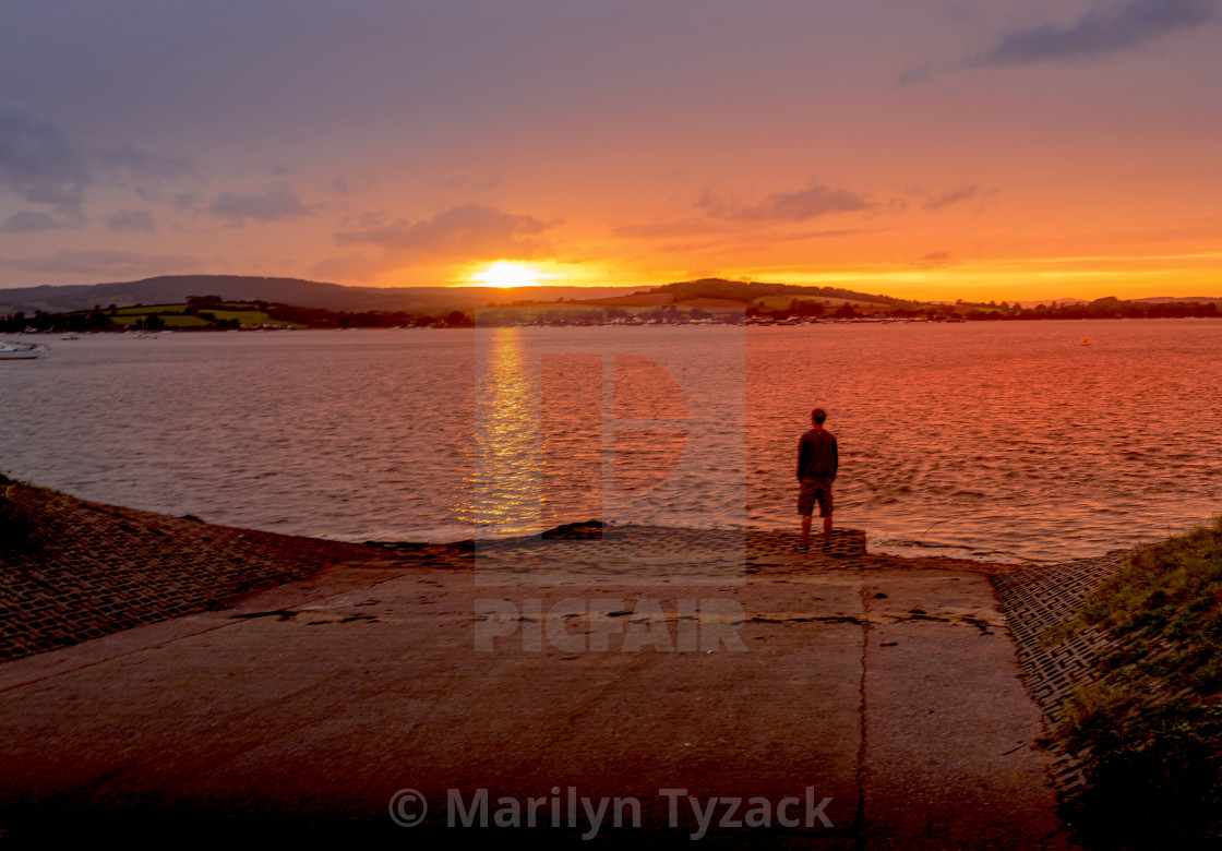 """""""Watching the sun go down"""" stock image"""