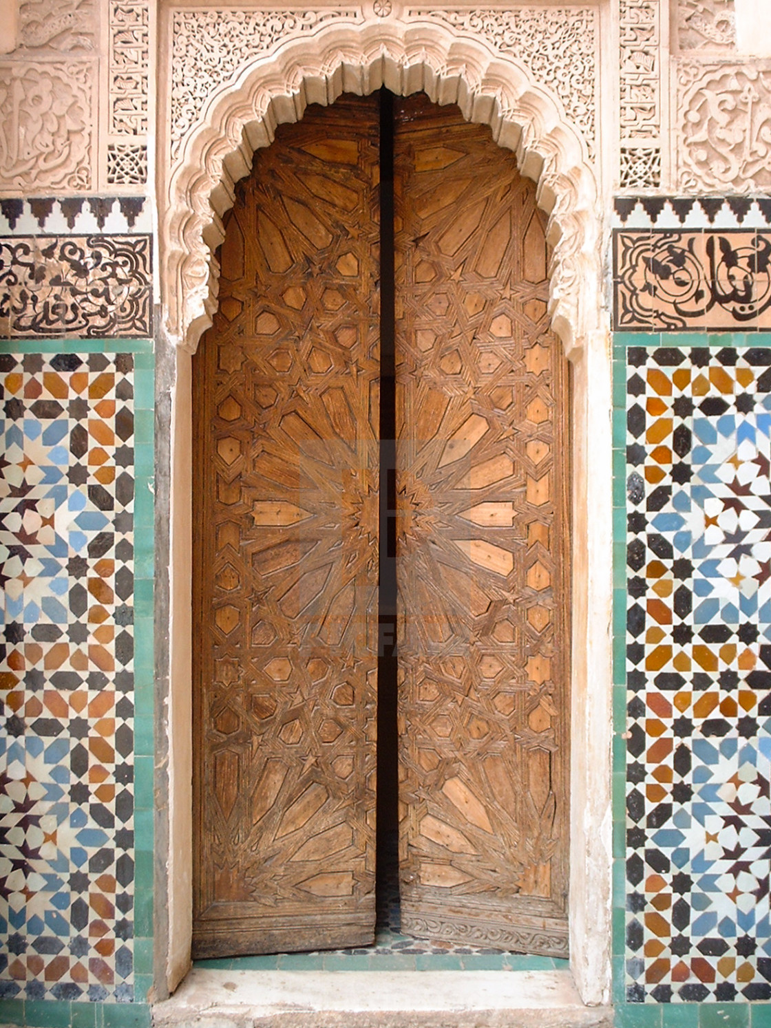 """Zellij and cedar door, Madrasa Ben Youssef, Medina, Marrakech, Morocco"" stock image"