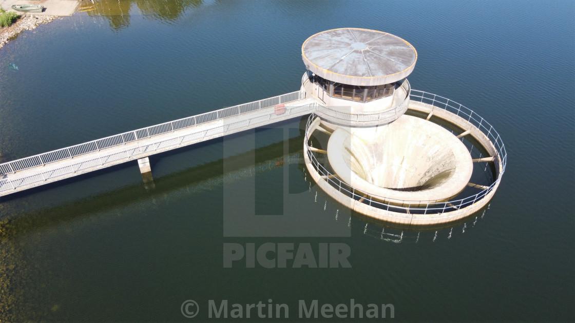 """Reservoir water shaft spillway."" stock image"
