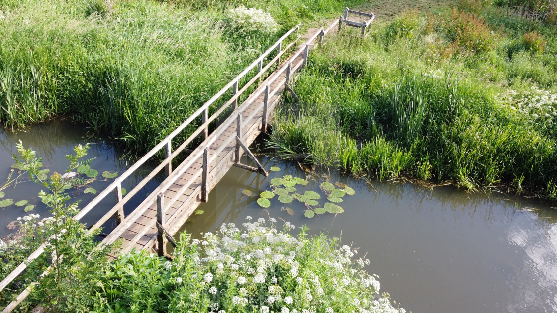 """""""Pedestrian footbridge over the River Ouse in Sussex, England."""" stock image"""