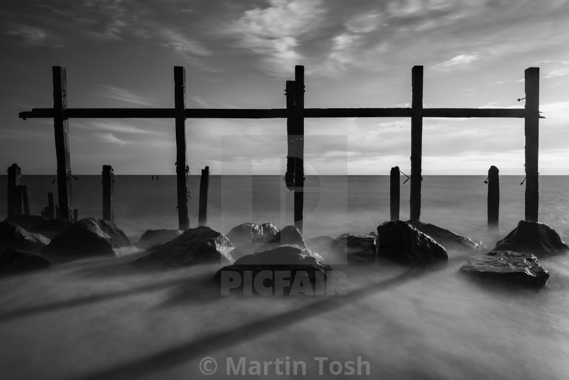 """Derelict sea defences mono on Happisburgh beach, Norfolk"" stock image"