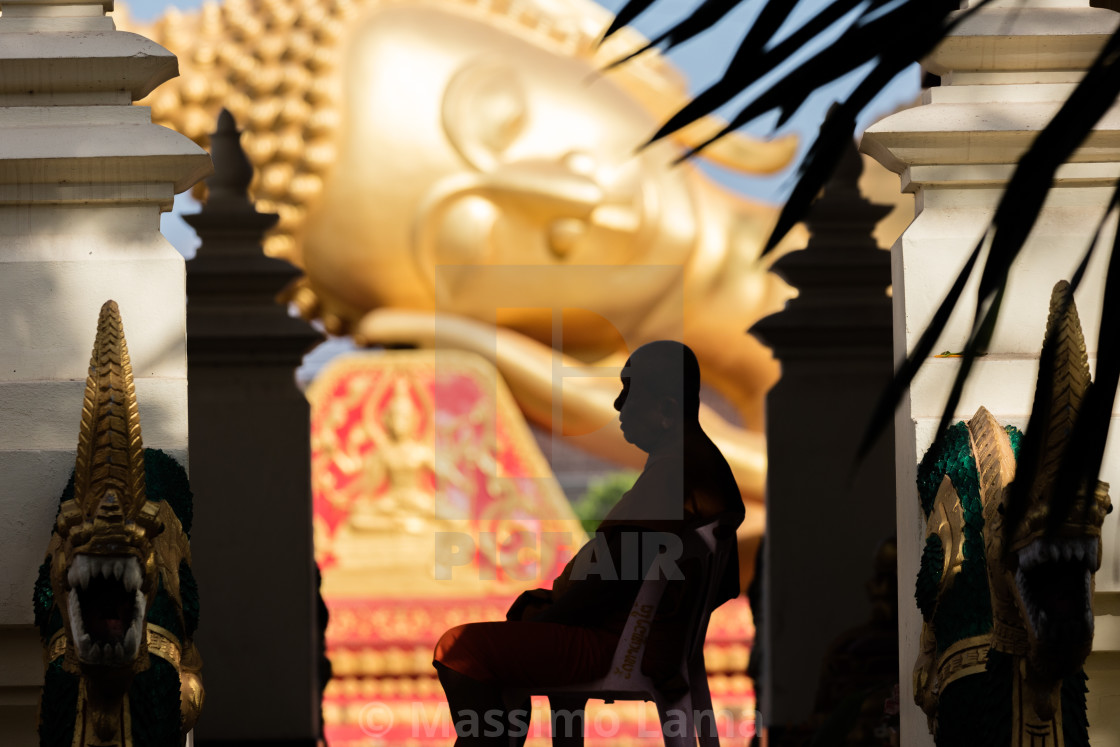 """Silhouette monk and Buddha"" stock image"