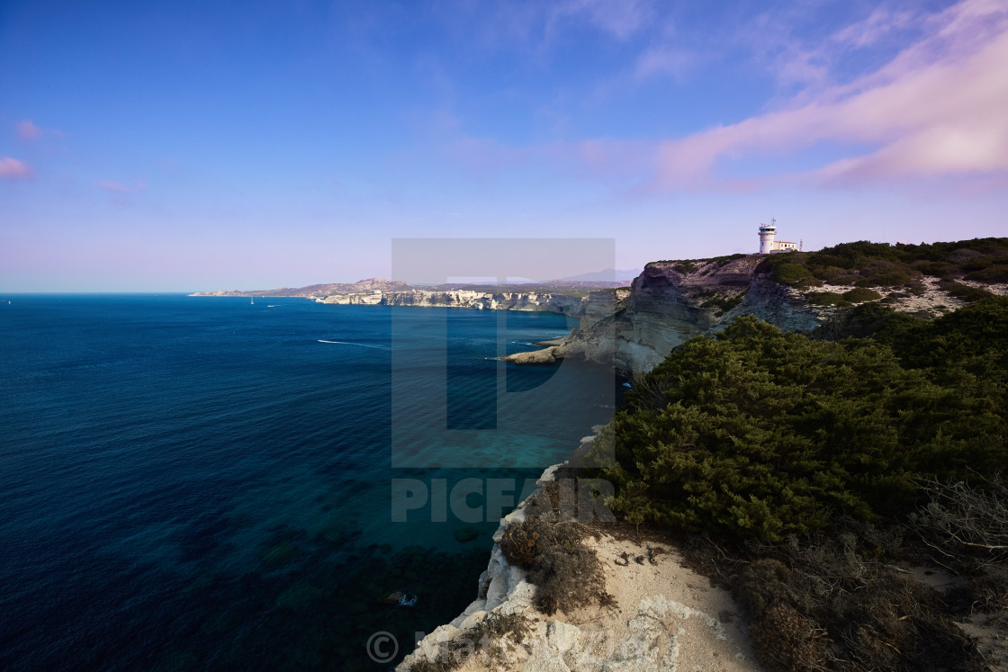 """Corse Lightouse over the rocks"" stock image"