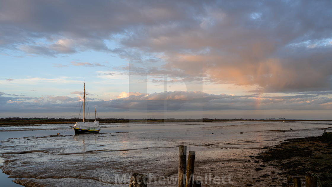 """""""Hamford Water In Essex With Rainbow"""" stock image"""