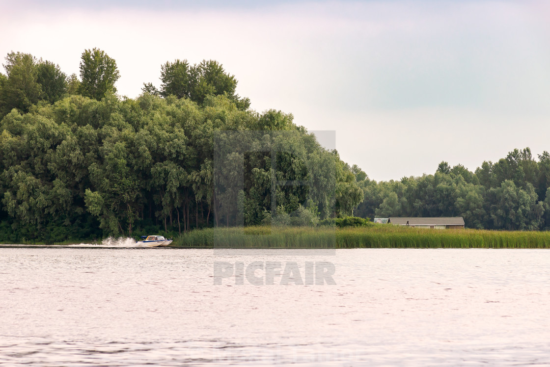 """A speedboat on the Dnieper river in Kiev, Ukraine, at the beginn"" stock image"