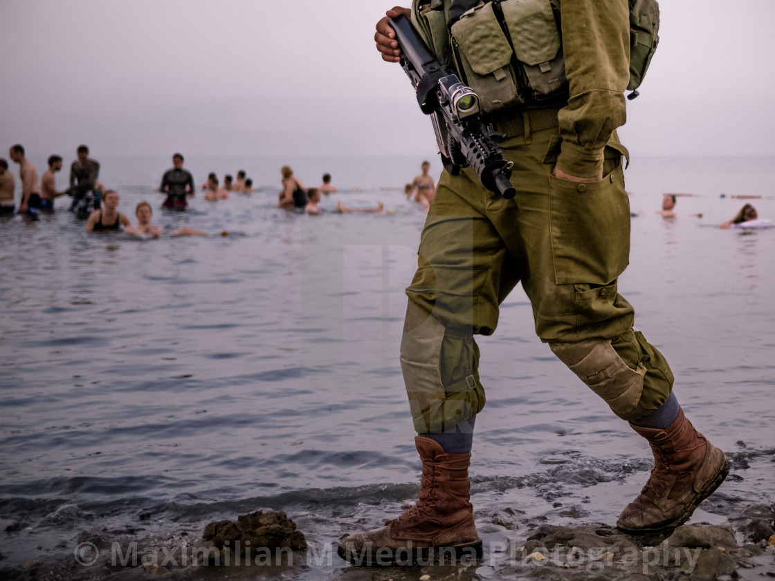"""""""IDF soldier and swimmers"""" stock image"""